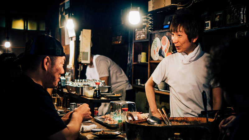 Japanese eatery saying san